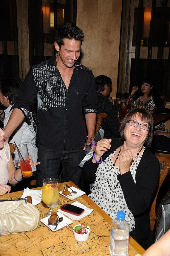 """Jeff Timmons and guest at """"Ultimate FANTASY"""" calendar party in Rice & Company at Luxor"""