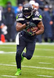 Marshawn Lynch ... doing what he does best.