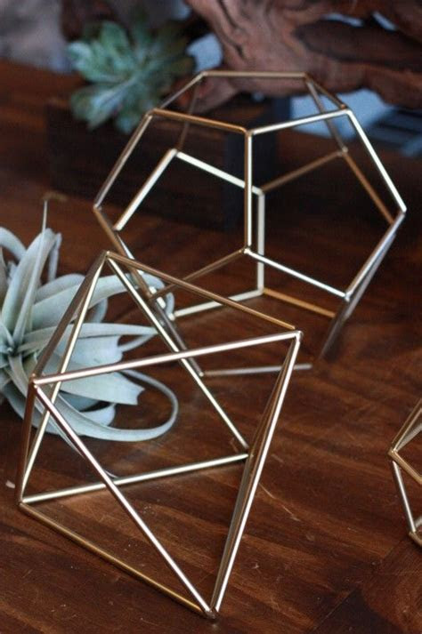 Love these gold geometric prisms for tabletop decor