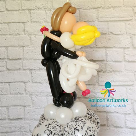 Bride and groom balloon sculpture. Approx 3ft tall. By