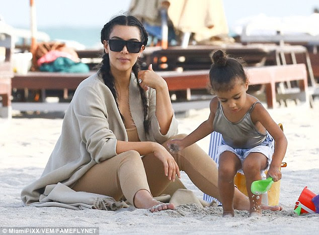 Repping Kanye?Never one to miss a fashion opportunity, the realty star left traditional beachwear at home in favour of an ensemble that looked like it had been plucked from her husband Kanye West's Yeezy collection