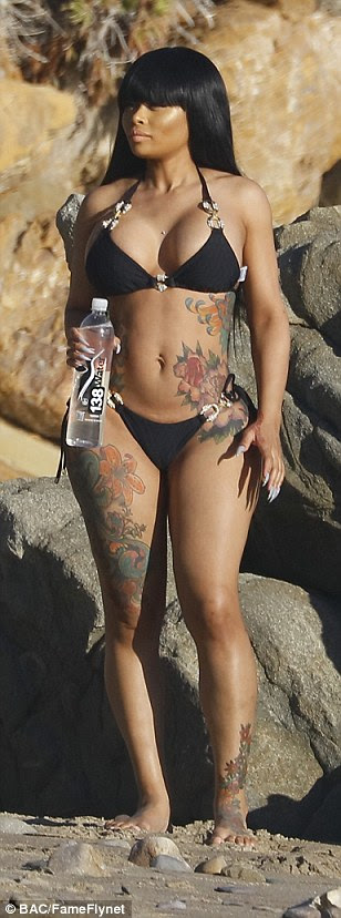Hourglass figure: Chyna displayed her shapely legs and svelte waist in the tiny two-piece with its gold buckle detailing