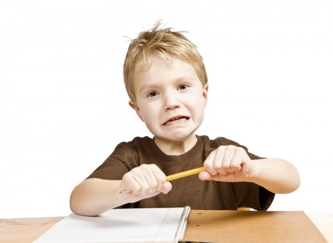 Frustrated-boy-breaking-pencil