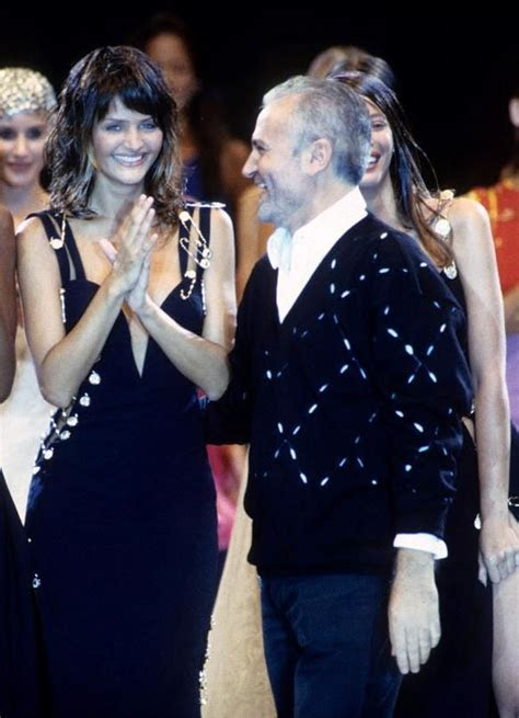 Gianni Versace and his famous safety pin dress, worn by