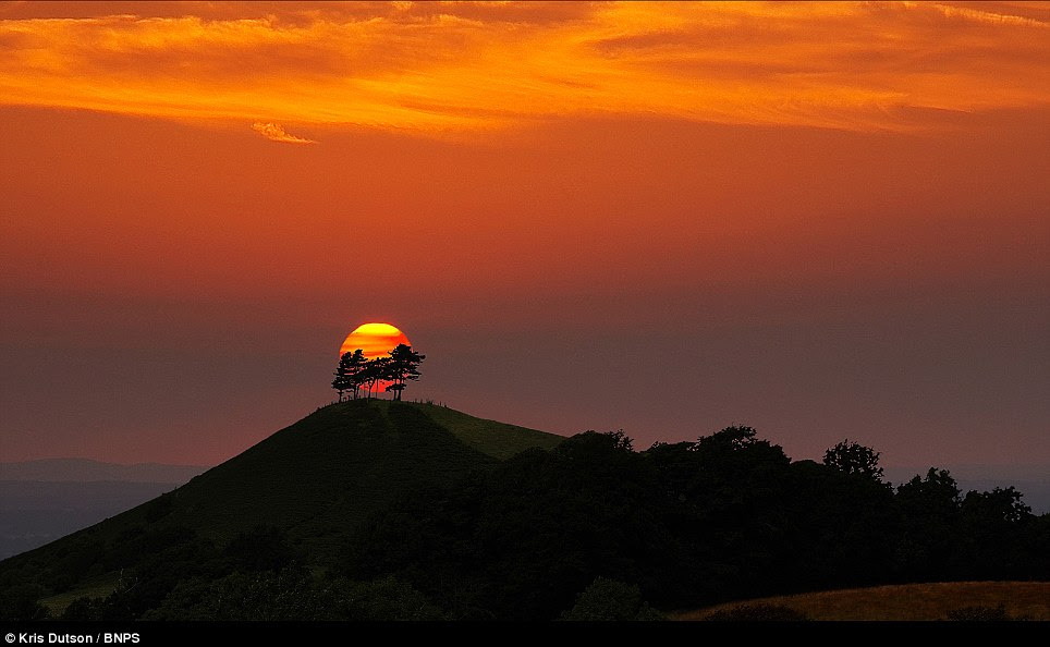 Red sky at night: The sun sets over Colmer' Hill in Bridport, Dorset with a covering of cloud overhead. The beautiful glowing skyline was caused by the ash cloud which caused airline chaos