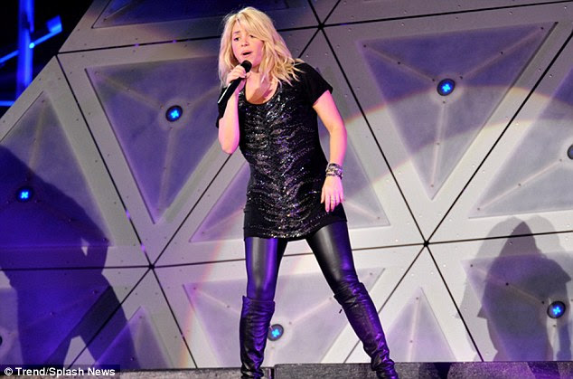 Crowd pleaser: Shakira showed she was a yummy mummy to be in her black get-up with knee-high boots for the performance