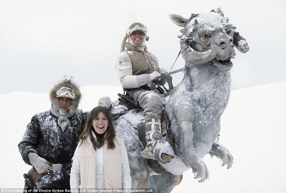 Smile please: Despite the freezing temperatures during filming in Norway, Harrison Ford, Carrie Fisher and Mark Hamill manage to crack a smile