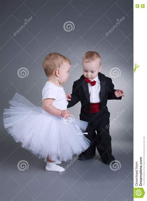 Cute Boy And Girl In Wedding Dress Stock Photo   Image of