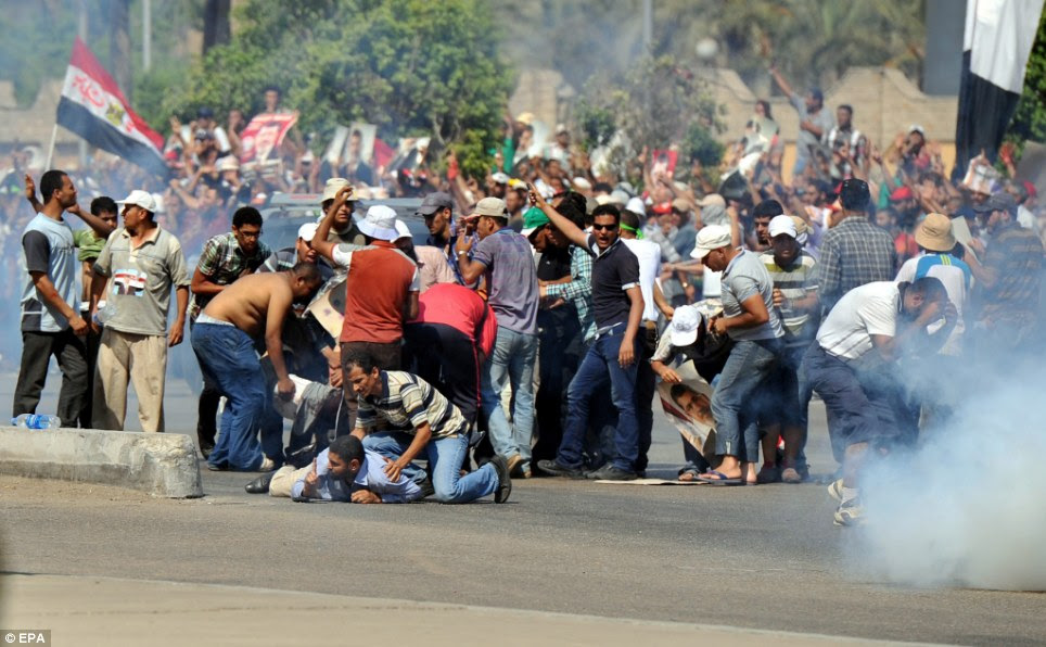 A second spring: Fighting between the Islamist leader's supporters and opponents have raised fears of deadly street violence in Egypt