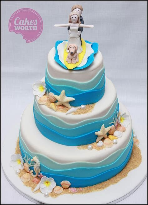 Beach themed wedding cake with edible decorations