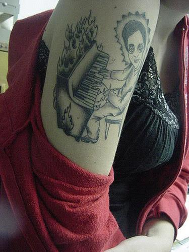 piano tattoo. tattoo work by Drew Norton