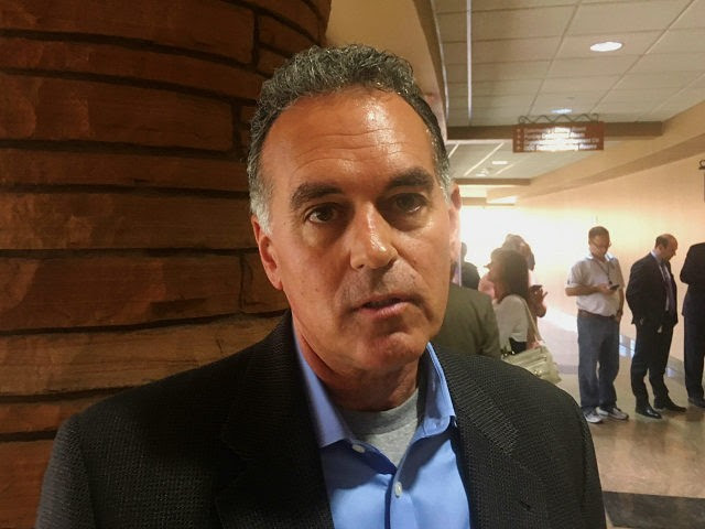 """Republican congressional candidate Danny Tarkanian talks with a reporter Friday, March 16, 2018, at the Clark County Government Center in Las Vegas about President Donald Trump asking him to switch from running for U.S. Senate to running for a Congress seat in Nevada. Tarkanian said Trump was """"adamant,"""" and said that he plans as a Congressman to be a steadfast supporter of Trump and his policies. (AP Photo/Ken Ritter)"""