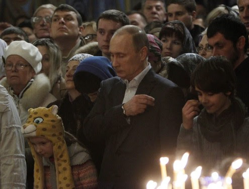 Vladimir Putin attends the Orthodox Christmas service