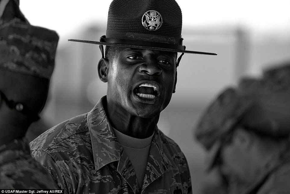 Training exercise: Military training instructor, Tech. Sergeant Chananyah Stuart, yells at trainees during an exercise. The normally smiling instructor has the ability to change his personality on a dime to instill fear in his trainees