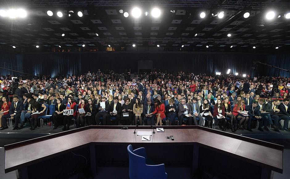 Before the beginning of Vladimir Putin's annual news conference.