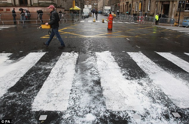 You'll need another coat: Rain washes away newly painted crossing lines