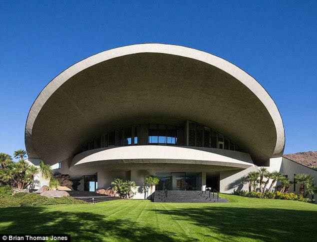 Futuristic: The home owes is space age look to a design by famed modernist architect John Lautner