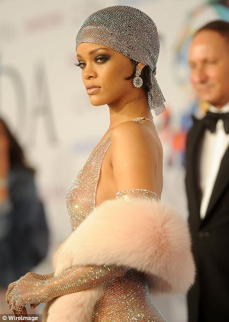 Stunning: While her outfit may have been designed to shock, there is no hiding Rihanna's natural beauty and the star was stunning with smokey eyes and nude lips