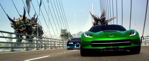 Sideswipe (foreground) and Drift (voiced by Ken Watanabe) are flanked by the Dinobots as they head towards battle in TRANSFORMERS: AGE OF EXTINCTION.