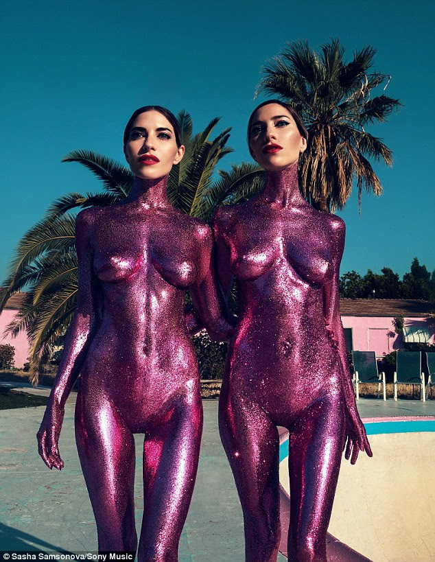 Bold move: The Veronicas singers Lisa and Jessica Origliasso pose completely naked on the cover of their next single In My Blood, with their bare bodies smothered with glittery purple paint