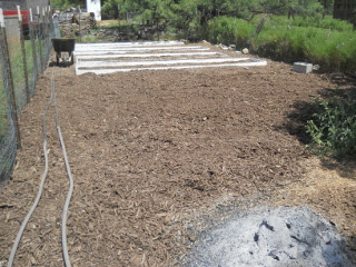 Mulching Over Raised Beds Area