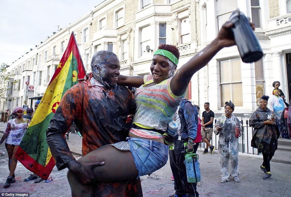 Revellers start the day's celebrations with the J'ouvert parade at the carnival's opening event celebrating Caribbean tradition