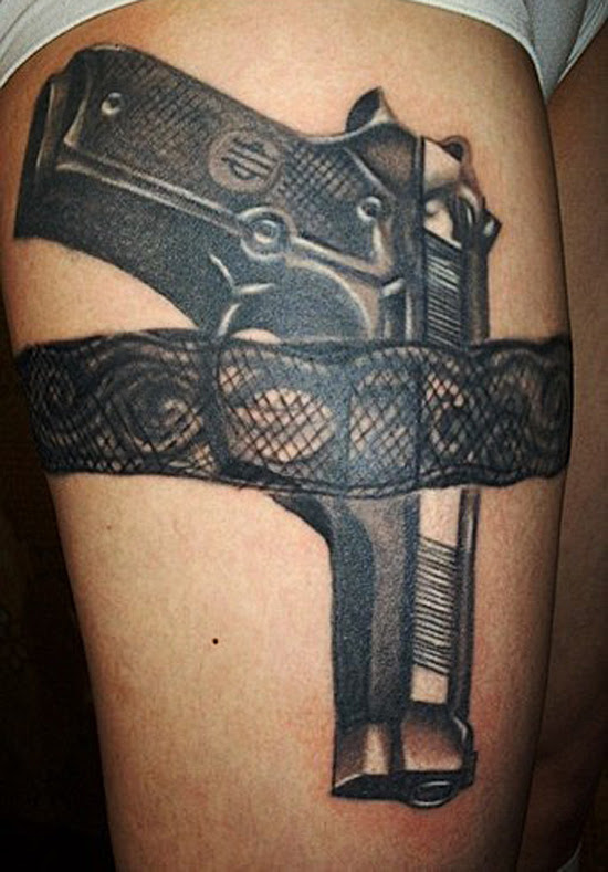 Amazing Black Gun Tattoo On Thigh