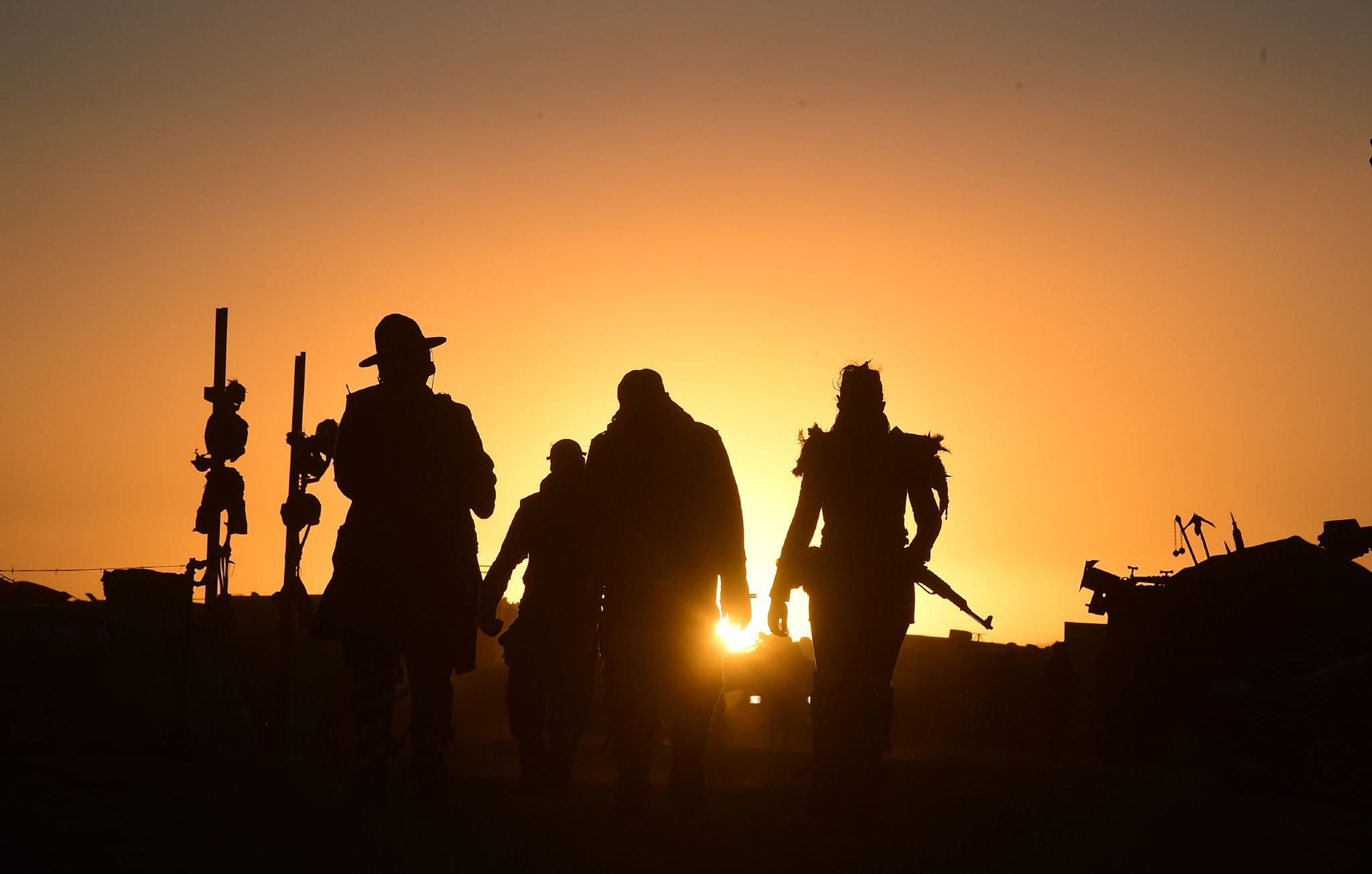 Festival goers arriving at sunset attend the first day of Wasteland Weekend in the high desert community of California City in the Mojave Desert, California, where people are gathering for the world's largest post-apocalyptic festival