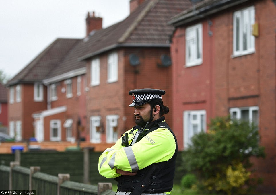 Police were standing outside Abedi's house in Fallowfield this morning as the hunt for possibly accomplices continued
