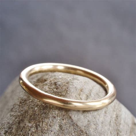 handmade 9ct yellow gold halo wedding ring by muriel