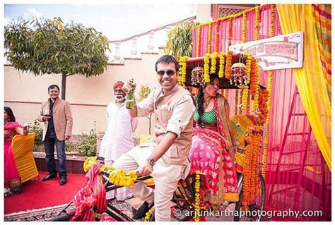 indian couple on a rickshaw wedding   Witty Vows