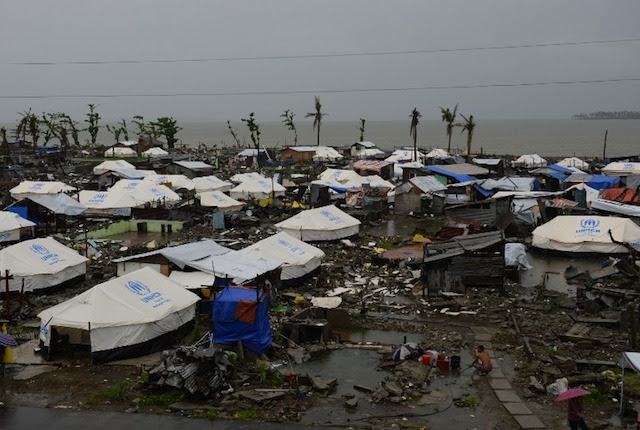 IN THE RAIN. Tents are erected as temporary shelters for residents whose houses were flattened by super Typhoon Haiyan in Tacloban city, Leyte province, on December 25, 2013. AFP/Ted Aljibe