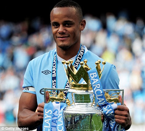 Vincent Kompany the captain of Manchester City poses with the trophy