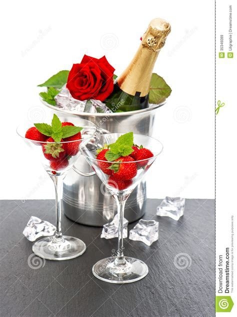 Champagne, Red Rose And Strawberries Over White Stock