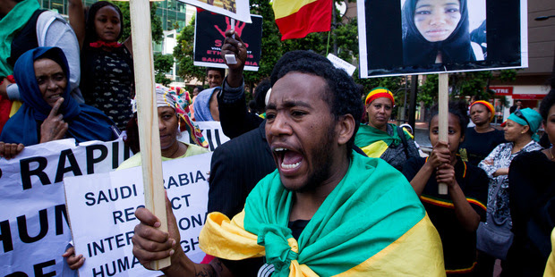 Teklay Zinaw protests alongside fellow Ethiopians in New Zealand outside the Saudi Arabian Consulate in Auckland denouncing Saudi Arabian crimes against their people. Photo / Richard Robinson