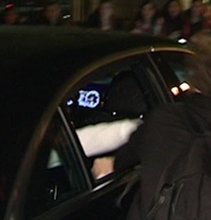 Whack: Justin's arm was seen extending from the vehicle where it was met with the fan's lip