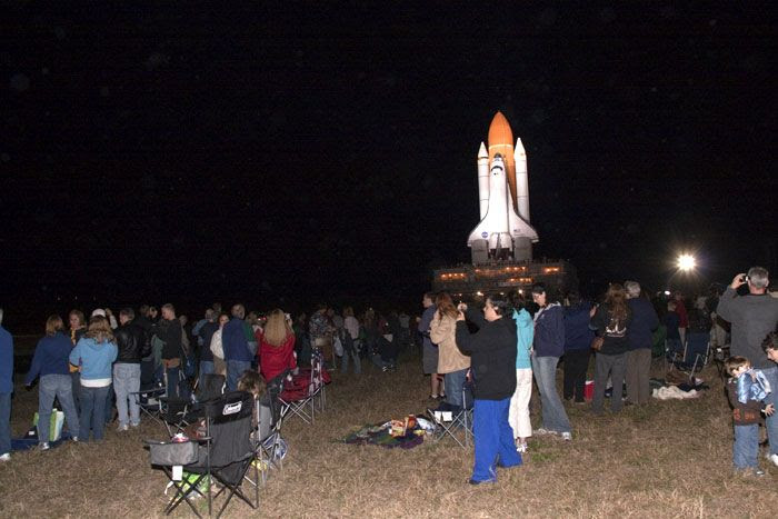 900 NASA employees and their families and friends watch as space shuttle Discovery heads back to LC-39A at the Kennedy Space Center in Florida, on January 31, 2011.