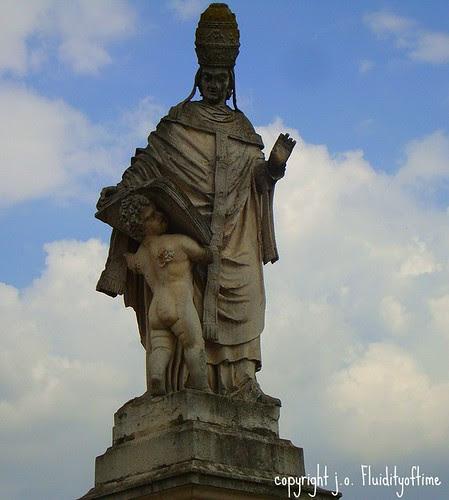 cherub holding book - Padua, Italy