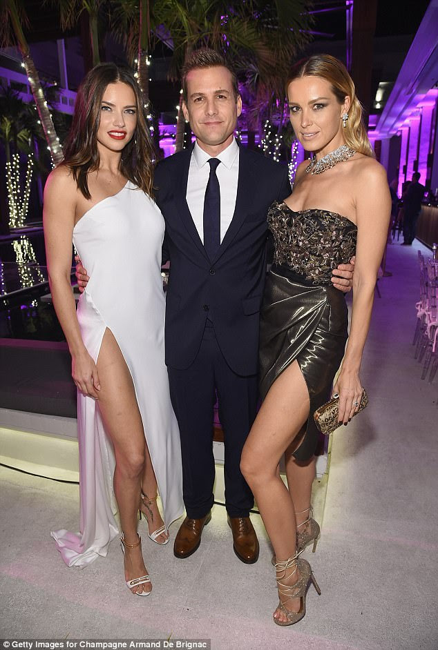 Troika:Adriana and Petra posed flanking an actor called Gabriel Macht, who had buttoned himself into a navy suit matching his tie, popping on a pair of camel-colored shoes