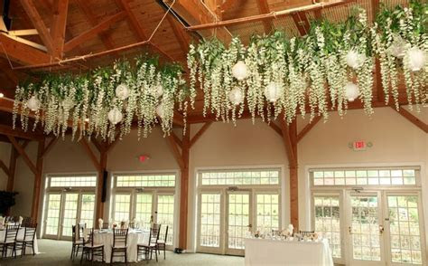 wisteria hanging flowers with lanterns over dance floor