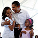 The first family took their dog, Bo, for a walk in 2009. President Obama's two daughters, Malia and Sasha, have been kept out of the campaign spotlight, but are often mentioned in speeches and interviews.