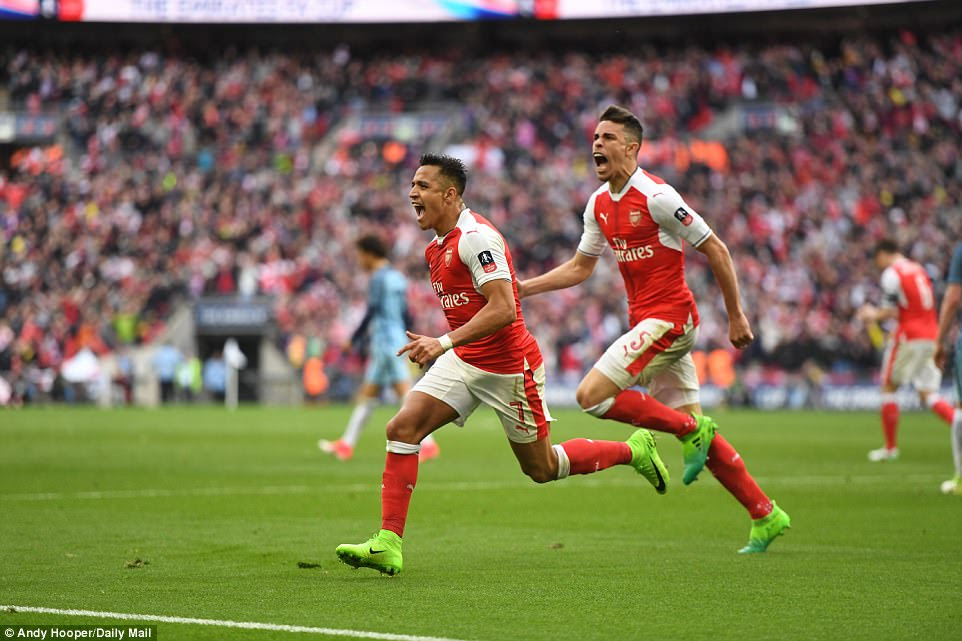 Sanchez races away to celebrate as his extra-time strike secured Arsenal's place in the FA Cup final