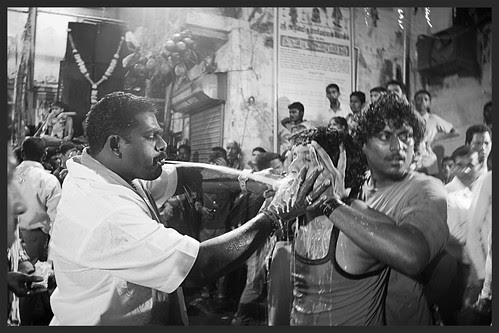 Spitting Milk In The Mouth To Seamlessly Remove The Rods From The Mouth After The Rod Piercing Ritual by firoze shakir photographerno1