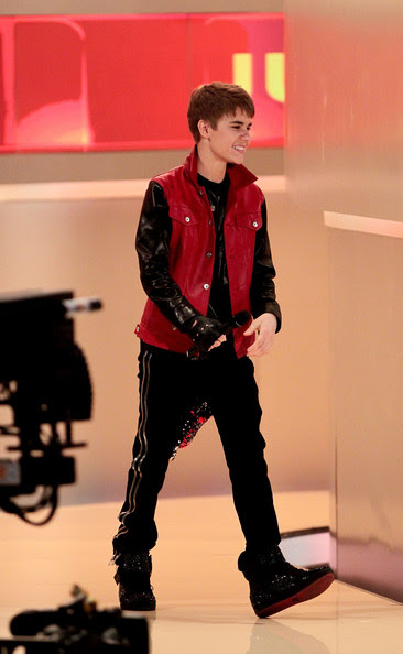 justin bieber is stylish in a black and red leather jacket
