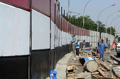 The wall around the embassy painted in colors of Egyptian flag (Photo: AFP)