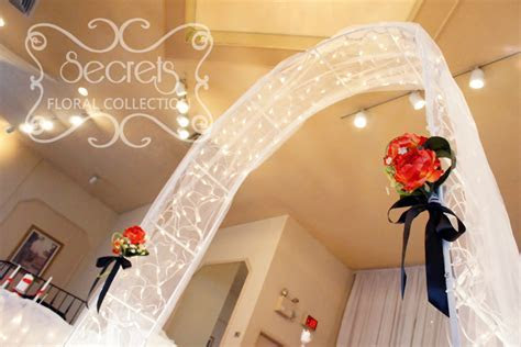 A Red, Black, and White Ceremony and Reception Decoration