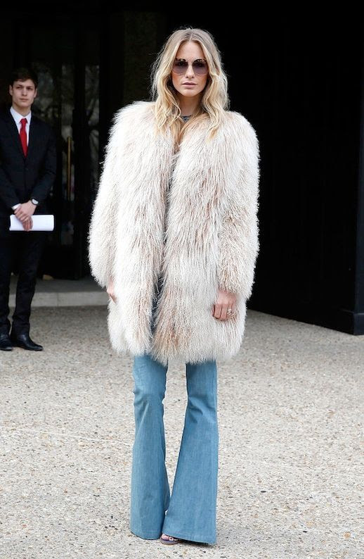 Le Fashion Blog Fall Winter Street Style Poppy Delevingne Round Sunglasses Shaggy Mongolian Fur Coat Denim Flares Via Pop Sugar