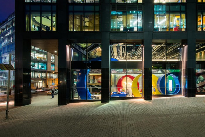 """The highly recognizable """"Google"""" letters in bright primaries can be seen as the focal point for the interior reception area and the outer entrance."""