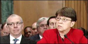 Mary Jo White, Testifying at Her Confirmation Hearing for SEC Chair on March 12, 2013; Her Husband, John W. White, Partner at Cravath, Swaine & Moore, Sits to Her Left