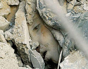 23gaza_massacres_person_dead_in_rubble.jpeg